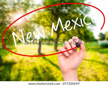 Man Hand writing New Mexico with black marker on visual screen. Isolated on nature. Business, technology, internet concept. Stock Photo - stock photo