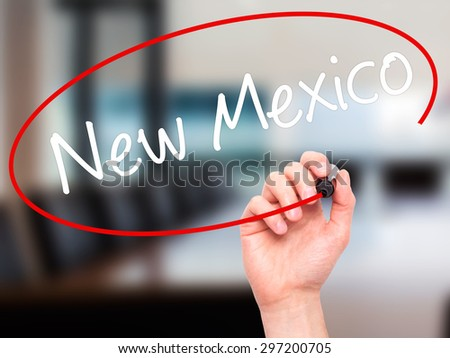 Man Hand writing New Mexico with black marker on visual screen. Isolated on office. Business, technology, internet concept. Stock Photo - stock photo