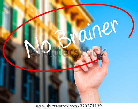 Man Hand writing No Brainer with black marker on visual screen. Isolated on city. Business, technology, internet concept.  - stock photo