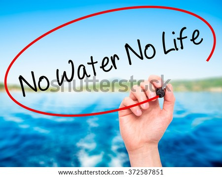Man Hand writing No Water No Life with black marker on visual screen. Isolated on background. Business, technology, internet concept. Stock Photo - stock photo