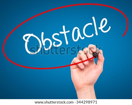 Man Hand writing Obstacle with black marker on visual screen. Isolated on background. Business, technology, internet concept. Stock Photo - stock photo
