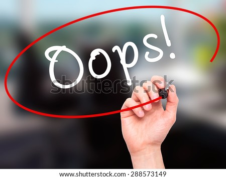 Man Hand writing Oops! with black marker on visual screen. Isolated on office. Business, technology, internet concept. Stock Image - stock photo