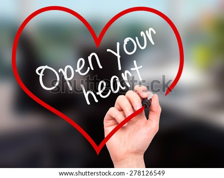 Man Hand writing Open your heart with marker on transparent wipe board. Isolated on office. Health, charity, internet, technology concept.  Stock Photo - stock photo