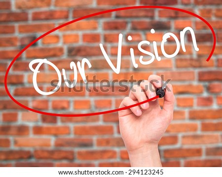Man Hand writing Our Vision with black marker on visual screen. Isolated on bricks. Business, technology, internet concept. Stock Photo - stock photo