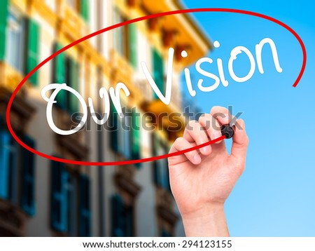 Man Hand writing Our Vision with black marker on visual screen. Isolated on city. Business, technology, internet concept. Stock Photo - stock photo