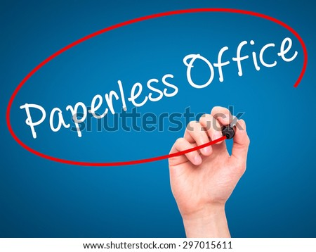 Man Hand writing Paperless Office  with black marker on visual screen. Isolated on blue. Business, technology, internet concept. Stock Photo - stock photo
