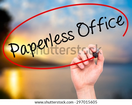 Man Hand writing Paperless Office  with black marker on visual screen. Isolated on nature. Business, technology, internet concept. Stock Photo - stock photo