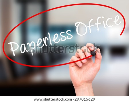 Man Hand writing Paperless Office  with black marker on visual screen. Isolated on offce. Business, technology, internet concept. Stock Photo - stock photo