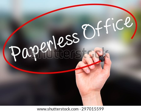 Man Hand writing Paperless Office  with black marker on visual screen. Isolated on office. Business, technology, internet concept. Stock Photo - stock photo