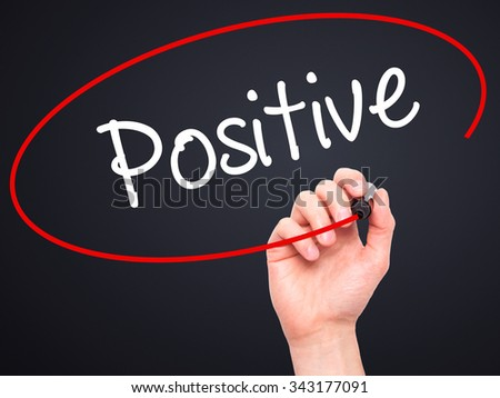 Man Hand writing Positive with black marker on visual screen. Isolated on black. Business, technology, internet concept. Stock Photo - stock photo