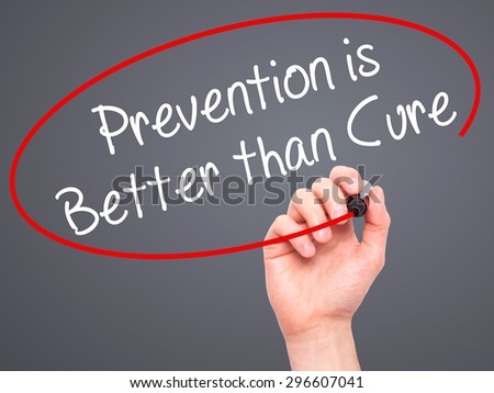Man Hand writing Prevention is Better than Cure with black marker on visual screen. Isolated on grey. Business, technology, internet concept. Stock Photo