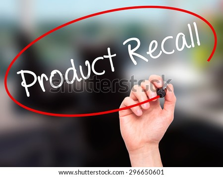 Man Hand writing Product Recall with black marker on visual screen. Isolated on office. Business, technology, internet concept. Stock Photo - stock photo