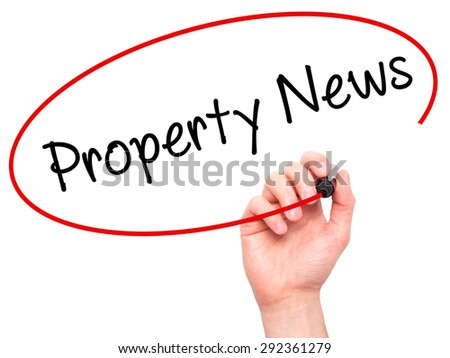 Man Hand writing Property News with black marker on visual screen. Isolated on white. Business, technology, internet concept. Stock Image - stock photo