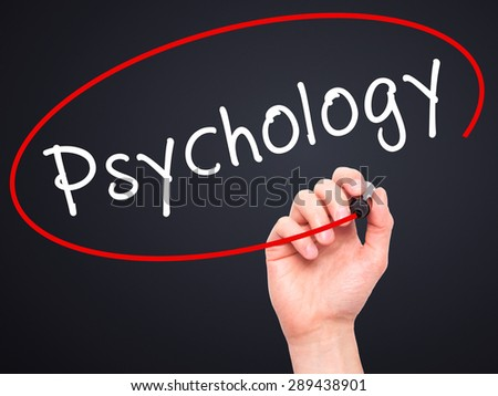 Man Hand writing Psychology with black marker on visual screen. Isolated on black. Business, technology, internet concept. Stock Image - stock photo
