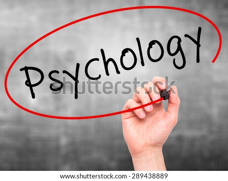 Man Hand writing Psychology with black marker on visual screen. Isolated on grey. Business, technology, internet concept. Stock Image - stock photo
