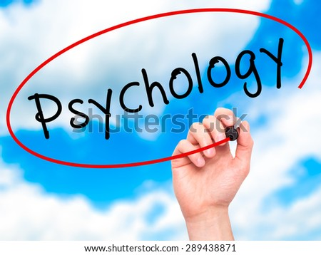 Man Hand writing Psychology with black marker on visual screen. Isolated on sky. Business, technology, internet concept. Stock Image - stock photo