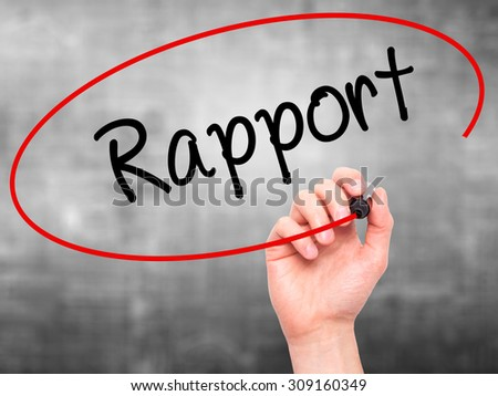 Man Hand writing Rapport with black marker on visual screen. Isolated on grey. Business, technology, internet concept. Stock Photo - stock photo