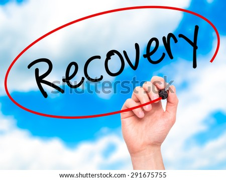 Man Hand writing  Recovery  with black marker on visual screen. Isolated on sky. Life, technology, internet concept. Stock Image - stock photo