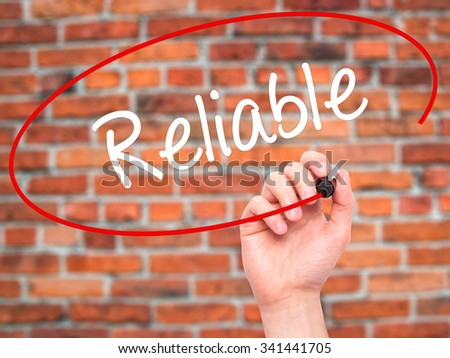 Man Hand writing Reliable with black marker on visual screen. Isolated on bricks. Business, technology, internet concept. Stock Photo - stock photo