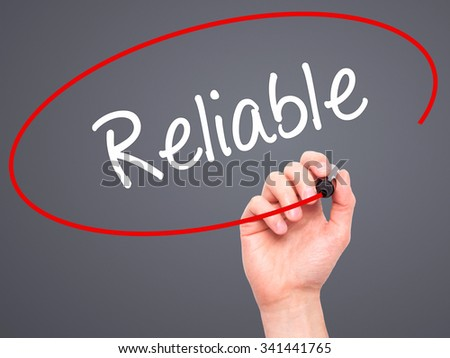 Man Hand writing Reliable with black marker on visual screen. Isolated on grey. Business, technology, internet concept. Stock Photo - stock photo