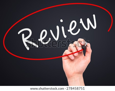 Man Hand writing Review with marker on transparent wipe board. Isolated on black. Business, internet, technology concept. Stock Photo - stock photo