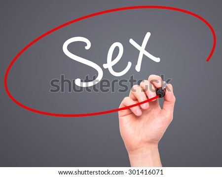 Man Hand writing Sex with black marker on visual screen. Isolated on grey. Business, technology, internet concept. Stock Photo