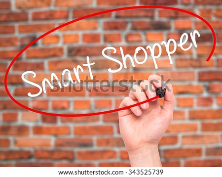 Man Hand writing Smart Shopper with black marker on visual screen. Isolated on bricks. Business, technology, internet concept. Stock Photo - stock photo