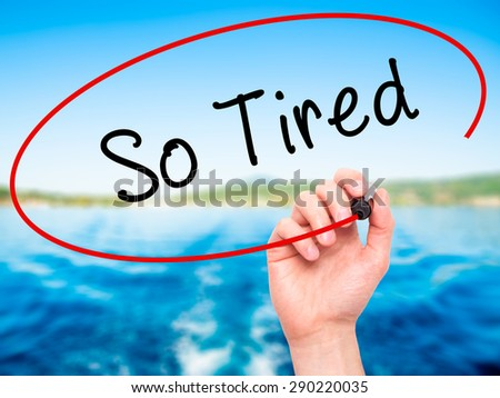 Man Hand writing So Tired with black marker on visual screen. Isolated on nature. Business, technology, internet concept. Stock Image  - stock photo