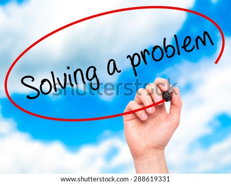 Man Hand writing Solving a problem with black marker on visual screen. Isolated on sky. Business, technology, internet concept. Stock Image - stock photo