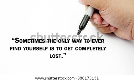 "Man Hand writing ""sometimes the only way to ever find yourself is to get completely lost"" with black marker on visual screen. Isolated white background. Business, technology, internet concept."