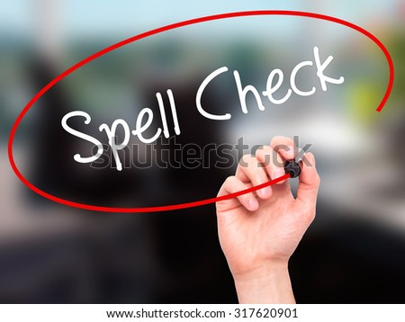 Man Hand writing Spell Check  with black marker on visual screen. Isolated on office. Business, technology, internet concept. - stock photo