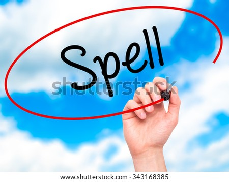 Man Hand writing Spell with black marker on visual screen. Isolated on sky. Business, technology, internet concept. Stock Photo - stock photo