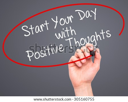 Man Hand writing Start your Dat with Positive Thoughts with black marker on visual screen. Isolated on grey. Business, technology, internet concept. Stock Photo