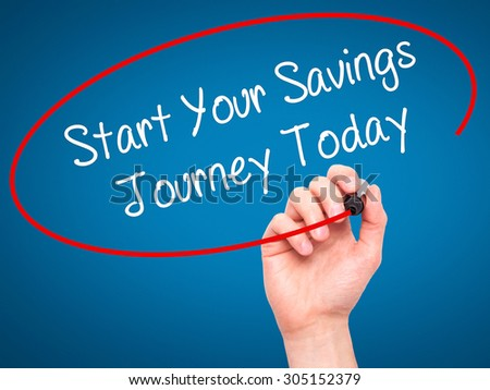 Man Hand writing Start Your Savings Journey Today with black marker on visual screen. Isolated on blue. Business, technology, internet concept. Stock Photo