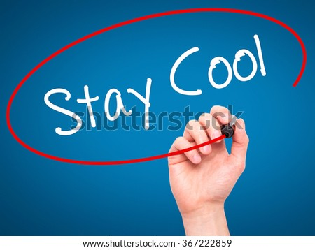 Man Hand writing Stay Cool   with black marker on visual screen. Isolated on background. Business, technology, internet concept. Stock Photo