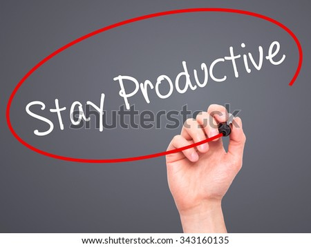 Man Hand writing Stay Productive with black marker on visual screen. Isolated on grey. Business, technology, internet concept. Stock Photo - stock photo