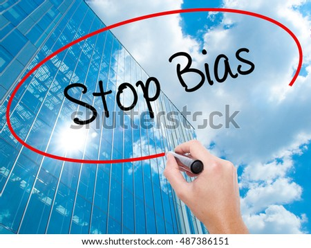 Man Hand writing Stop Bias with black marker on visual screen. Business, technology, internet concept.
