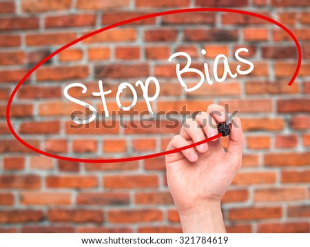 Man Hand writing Stop Bias with black marker on visual screen. Isolated on bricks. Business, technology, internet concept.  - stock photo