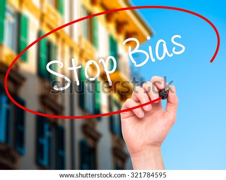 Man Hand writing Stop Bias with black marker on visual screen. Isolated on city. Business, technology, internet concept.  - stock photo