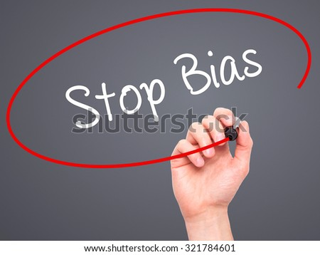 Man Hand writing Stop Bias with black marker on visual screen. Isolated on grey. Business, technology, internet concept.  - stock photo