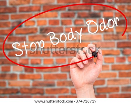 Man Hand writing Stop Body Odor with black marker on visual screen. Isolated on background. Business, technology, internet concept. Stock Photo - stock photo