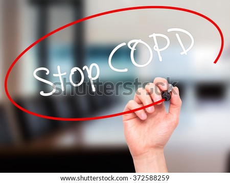 Man Hand writing Stop COPD with black marker on visual screen. Isolated on background. Business, technology, internet concept. Stock Photo - stock photo