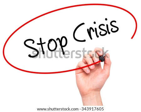 Man Hand writing Stop Crisis with black marker on visual screen. Isolated on background. Business, technology, internet concept. Stock Photo - stock photo