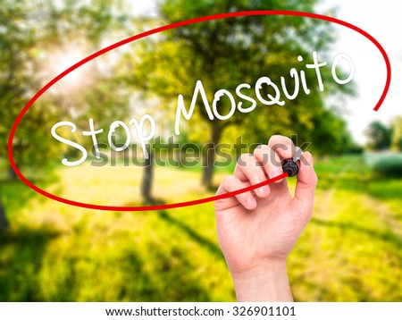 Man Hand writing Stop Mosquito with black marker on visual screen. Isolated on nature. Business, technology, internet concept. Stock Photo - stock photo