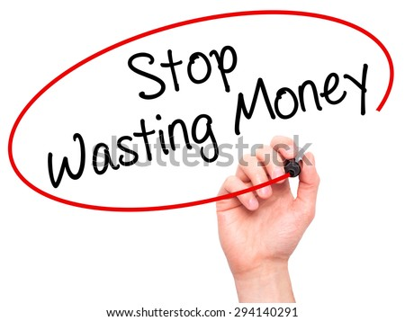 Man Hand writing Stop Wasting Money with black marker on visual screen. Isolated on white. Business, technology, internet concept. Stock Photo - stock photo