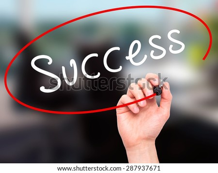 Man Hand writing Success with black marker on visual screen. Isolated on office. Business, technology, internet concept. Stock Image - stock photo