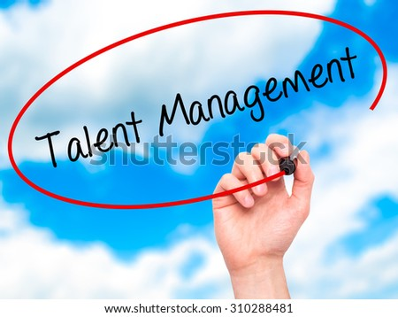 Man Hand writing Talent Management with black marker on visual screen. Isolated on sky. Business, technology, internet concept. Stock Photo - stock photo