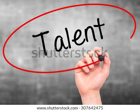 Man Hand writing Talent  with black marker on visual screen. Isolated on grey. Business, technology, internet concept. Stock Photo - stock photo
