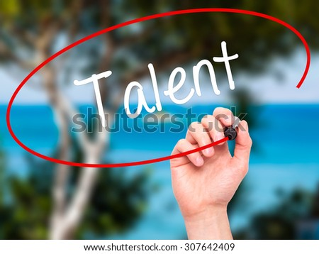 Man Hand writing Talent  with black marker on visual screen. Isolated on nature. Business, technology, internet concept. Stock Photo - stock photo
