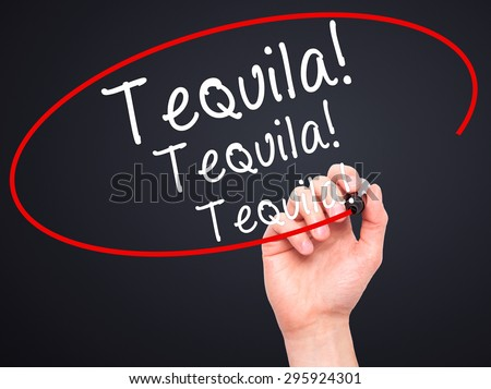 Man Hand writing Tequila with black marker on visual screen. Isolated on black. Business, technology, internet concept. Stock Photo - stock photo